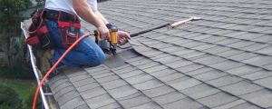 image of roofer fixing storm damage