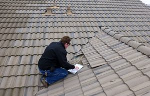 Photo of Main Street GC Inc roofer performing an inspection