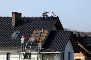 photo of Main Street GC Inc roofer at work