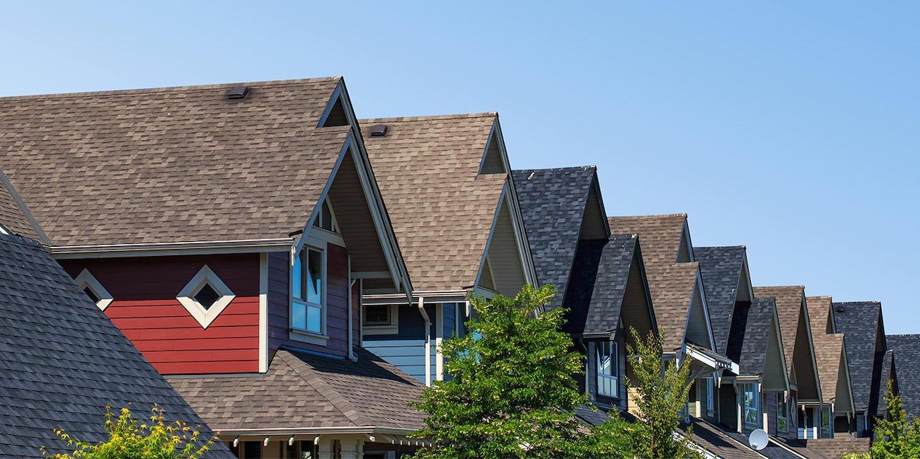 row of town houses with new shingle roofs